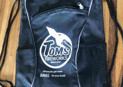 Tom's Fireworks branded cinch pack
